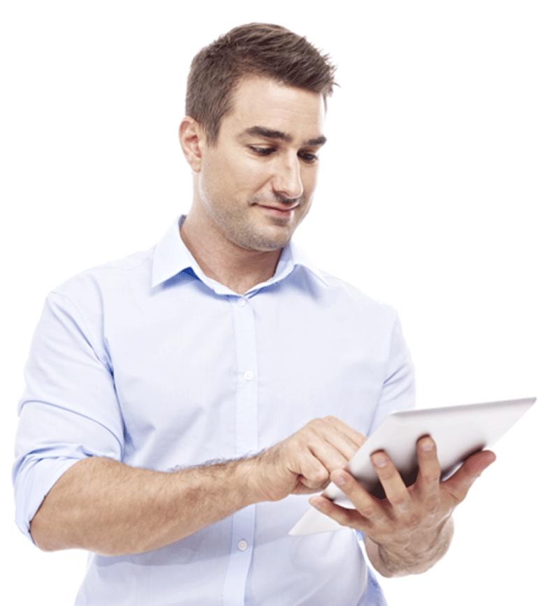 Smiling man looking at tablet.